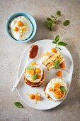 Toffee tartlets with orange cream cheese and physalis