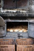 Freshly baked bread rolls in a wood-fired oven