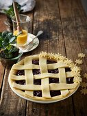 An unbaked pie with berries, cherries, rose water and a lattice top