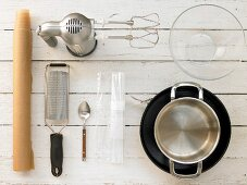 Kitchen utensils for making a cheesecake with a biscuit base