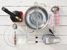 Kitchen utensils for making creme brulee with bay leaf and lemon peel