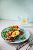 Avocado with baked egg and salsa