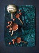 Hazelnut cream in brass measuring cups