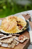Brie wrapped in puff pastry with dried tomatoes and thyme