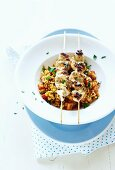 Tabouleh with grilled chicken skewers