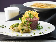 Veal tartare with monkfish and cheese and pepper pies