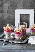Vegan berry cakes in a glass with a nut crumble topping