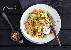 Farfalle with paprika, cabbage and smoked almonds (vegetarian)