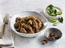 Rendang (Indonesian beef curry) with lemon leaves