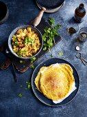 Potato and cauliflower curry with bean pancakes (India)