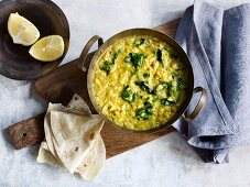 Vegetarian coconut lentils with baby leaf spinach (Asia)