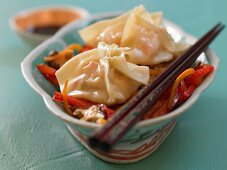 Shrimp wontons with wok vegetables