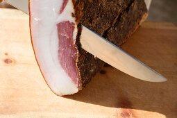 Mezet bacon being sliced at the Hofmanufaktur Kral in South Tyrol