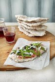Focaccia with ham, rocket, parmesan and olives