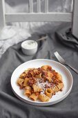 Mezze rigate with bolognese ragu and grated parmesan