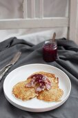 Raggmunk is traditional Swedish potato pancake, fried in butter, served with fried pork and lingonberries