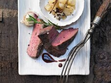 Venison steak with spiced pears