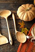 Fall diner celebration in the country, wooden spoons with leaves and pumpkin