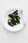 Mushroom ravioli with mussels, Parmesan and chives