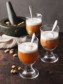 Wintry baked apple punch with roasted almonds and cream