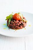 Lamb tartare with cherry tomatoes and rocket