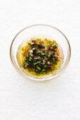 Herb vinaigrette in a glass bowl