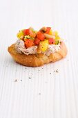 A crostini with tuna and peppers