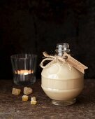 Homemade gingerbread liqueur in a decorative bottle for gifting