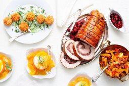 A Christmas meal with roast turkey roll, salmon cakes and parfait