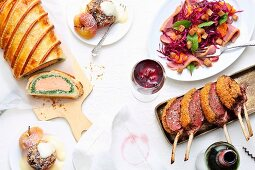 A Christmas meal with salmon en croûte, loin of venison, red cabbage and baked apple