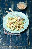 Courgette sala with raisins, sunflower seeds and yogurt sauce