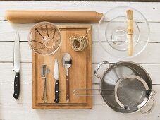 Kitchen utensils for cooking vegetables in parchment