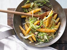 Carrot noodles with hazelnuts and white cabbage