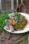 Potato fritters with wild mushrooms in a creamy sauce