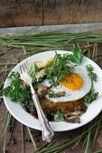 Potato fritters with a fried egg and fried mushrooms
