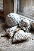 Silver Christmas decorations next to old window