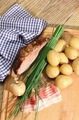 Ingredients for 'Tiroler Gröstl' (Tyrolean roast meat and potatoes)