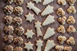 Butter cookies with walnuts and almonds on baking paper