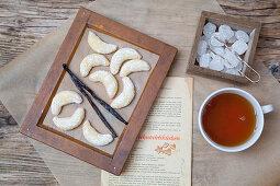 Vanilla crescent biscuits, tea and rock candy sugar cubes