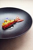 Gamba carabinero with carrot, pineapple, green pointed pepper and lemon grass stock, a dish by Jan Hartwig, the chef at the 'Atelier' restaurant in Munich