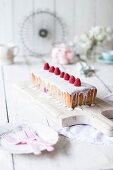Cream cake with raspberries and sugar