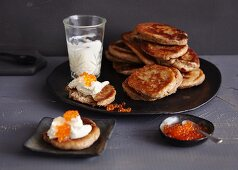 Blinis with cream cheese and salmon caviar (Russia)