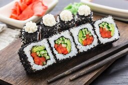 Sushi roll with salmon, shrimp and tomato
