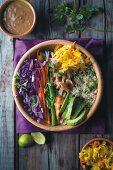 Power Bowl with quinoa, chicken, avocado, vegetables and peanut dip