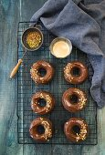 Donuts with a chocolate glaze and chopped nuts