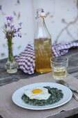 Stinging nettles with bacon and fried egg