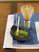Matcha powder and a tea whisk (Japan)