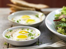 Baked quail eggs in soy cream with truffle oil