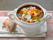 Grandmother's style chicken soup with vegetables and wholegrain noodles