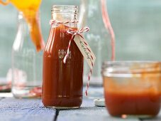 Homemade ketchup in a glass bottle